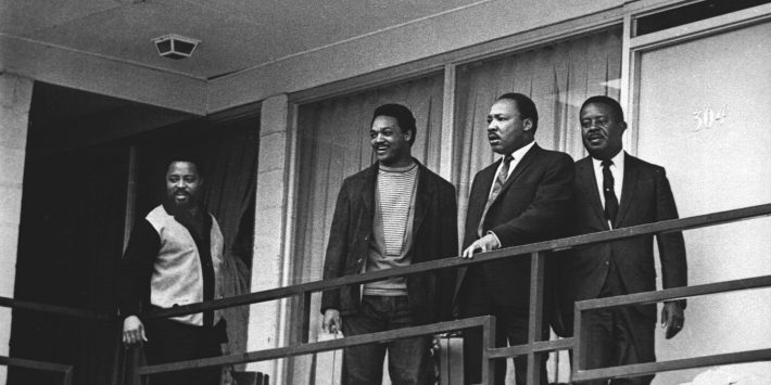 In this April 3, 1968 file photo, the Rev. Martin Luther King Jr. stands with other civil rights leaders on the balcony of the Lorraine Motel in Memphis, Tenn., a day before he was assassinated at approximately the same place.