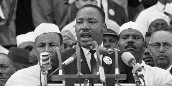 "In this Aug. 28, 1963, file photo, Dr. Martin Luther King Jr., head of the Southern Christian Leadership Conference, addresses marchers during his ""I Have a Dream"" speech at the Lincoln Memorial in Washington."