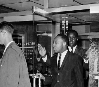 Civil rights leader Dr. Martin Luther King Jr. exits Rich's department store in Atlanta, Ga., Oct. 19, 1960.