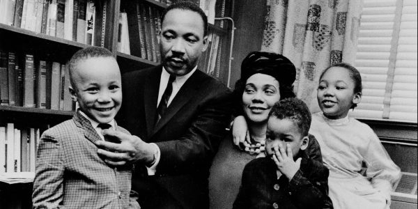 Dr. Martin Luther King Jr. and his wife, Coretta Scott King, sit with three of their four children in their Atlanta, Ga, home, on March 17, 1963.