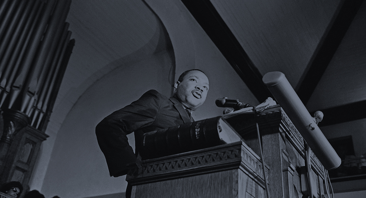 "Dr. Martin Luther King Jr., tells a mass meeting in Birmingham, Alabama Sept. 17, 1963 that ""words and actions"" of Alabama Gov. George Wallace were to blame for the deaths of four African American girls in a church bombing. The meeting of about 1,200 persons voted to state a march on the state capitol in Montgomery to protest racial violence. (AP Photo)"